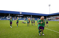 29 APR 2009 - LONDON,GBR -  Leeds Met Carnegie (green and purple) celebrate their victory over Northumbria University (white and red) in the 2009 BUCS Womens Football Championship Final. (PHOTO (C) NIGEL FARROW)