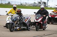 May 20, 2017; Topeka, KS, USA; NHRA safety safari crew push top fuel nitro Harley Davidson rider Bob Malloy during qualifying for the Heartland Nationals at Heartland Park Topeka. Mandatory Credit: Mark J. Rebilas-USA TODAY Sports