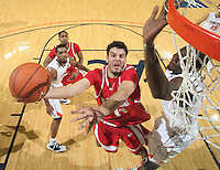 Dec. 07, 2010; Charlottesville, VA, USA;  Radford Highlanders forward Tolga Cerrah (41) shoots the ball next to Virginia Cavaliers center Assane Sene (5) during the game at the John Paul Jones Arena. Virginia won 54-44. Mandatory Credit: Andrew Shurtleff