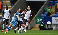 Bolton Wanderers' Dennis Politic (no. 22) breaks away from Coventry City's Zain Westbrooke <br /> <br /> Photographer Andrew Kearns/CameraSport<br /> <br /> The EFL Sky Bet Championship - Bolton Wanderers v Coventry City - Saturday 10th August 2019 - University of Bolton Stadium - Bolton<br /> <br /> World Copyright © 2019 CameraSport. All rights reserved. 43 Linden Ave. Countesthorpe. Leicester. England. LE8 5PG - Tel: +44 (0) 116 277 4147 - admin@camerasport.com - www.camerasport.com