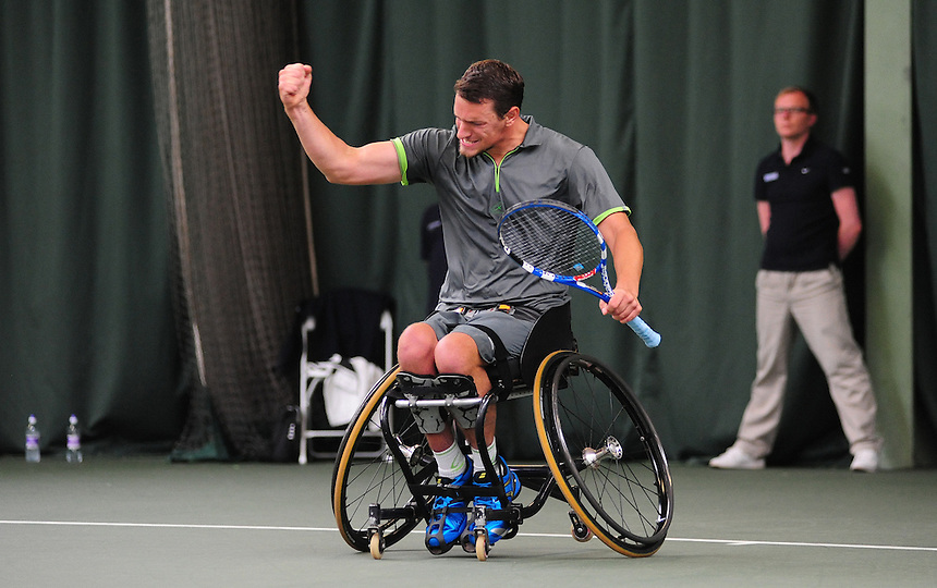 Joachain Gerard (BEL) [5] celebrates his victory over Stephane Houdet (FRA) [1] in the Men's Single Final - Joachim Gerad (BEL) [5] def Stephane Houdet (FRA) [1] 6-2 3-6 6-3<br /> <br /> Tennis - British Open Wheelchair Tennis Championships - Sunday 21st July 2012 - Nottingham Tennis Centre - Nottingham<br /> <br /> &copy; Tennis Foundation/James Jordan - The National Tennis Centre - 100 Priory Lane - Roehampton - London - SW15 5JQ - Tel 020 8487 7304 - info@tennisfoundation.org.uk
