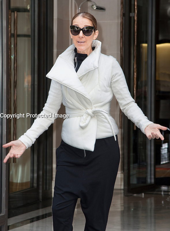 June 23, PARIS, FRANCE : Singer Céline Dion leaves the Royal Monceau Hotel on Avenue Hoche