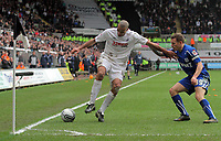 ATTENTION SPORTS PICTURE DESK<br /> Pictured L-R: Darren Pratley of Swansea tries to keep the ball in game while closely marked by Craig Bellamy of Cardiff.<br /> Re: npower Championship Swansea City FC v Cardiff City FC at the Liberty Stadium, south Wales. Sunday 06 February 2011