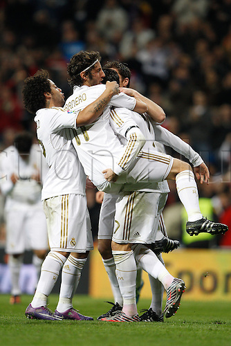 22.01.2012. Madrid Spain. La Liga  The match played between  Real Madrid and Athletic Club de Bilbao (4-1)  played at the Santiago Bernabeu Stadium.  Picture show players of Real Madrid CF celebrating his team's goal