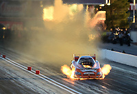 Oct. 27, 2012; Las Vegas, NV, USA: NHRA funny car driver Todd Lesenko explodes an engine during qualifying for the Big O Tires Nationals at The Strip in Las Vegas. Mandatory Credit: Mark J. Rebilas-