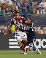 Desparate defense by New England Revolution defender Ryan Cochrane (45) on Chivas USA forward Justin Braun (17). In a Major League Soccer (MLS) match, Chivas USA defeated the New England Revolution, 3-2, at Gillette Stadium on August 6, 2011.