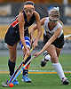 Garden City No. 28 Emily Clarke, right, and Manhasset No. 24 Juliana Baydar battle for possession during the Nassau County varsity field hockey Class B final at Adelphi University on Sunday, November 1, 2015. Garden City won by a score of 9-0.<br /> <br /> James Escher