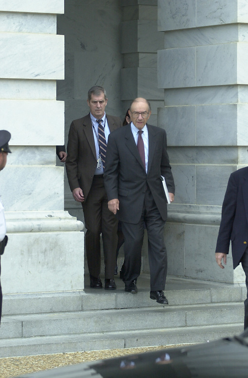 1greenspan091901 -- Allen Greenspan, leaving a meeting at the Capital which also included former Treasury Secretary Robert Rubin, in route to the White House for a meeting with President Bush on Wednesday.