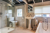 BNPS.co.uk (01202 558833)<br /> Pic: PurpleBricks/BNPS<br /> <br /> You'll have steamy windows after a hot shower in this former victorian rail carriage. <br /> <br /> This £475,000 seaside cottage contains a charming secret – it's built around two Victorian railway carriages.<br /> <br /> The 19th century carriages were used as temporary housing for soldiers returning from the First World War when there was a shortage of homes.<br /> <br /> But many of them remained in place years later and had bricks and mortar built around them.<br /> <br /> And so from the street view they looked like normal houses but inside the main reception rooms were with the converted carriages.