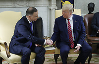 US President Donald J. Trump (R) shakes hands with Polish President Andrzej Duda (L)  during a meeting in the Oval Office of the White House in Washington, DC, USA, 12 June 2019. Later in the day President Trump and President Duda will participate in a signing ceremony to increase military to military cooperation including the purchase of F-35 fighter jets and an increased US troop presence in Poland. <br /> Credit: Shawn Thew / Pool via CNP/AdMedia