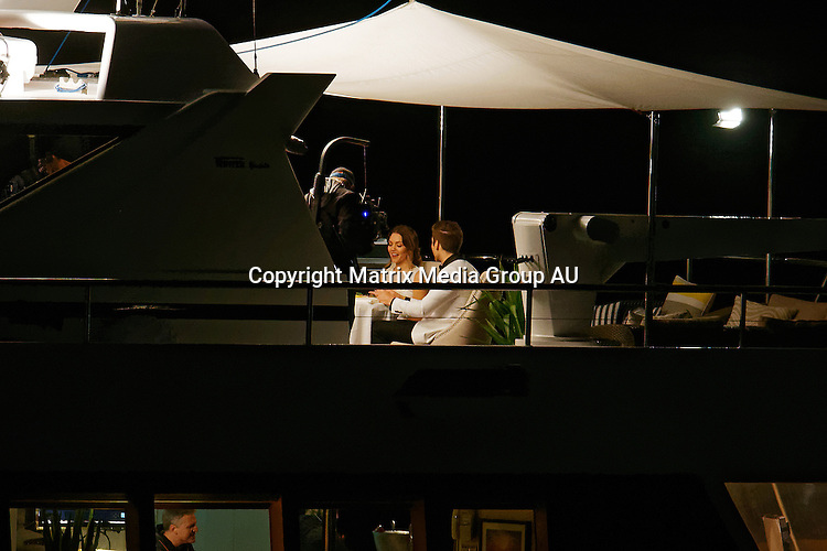 10 JUNE 2015 SYDNEY AUSTRALIA<br /> <br /> EXCLUSIVE PICTURES<br /> <br /> Australia's first Bachelorette Sam Frost pictured aboard the super yacht Ghost II for a double date with two finalist contestant during filming of Bachelorette Australia. Sam stood on the upper aft deck in a white cocktail dress purring as her handsome dates made their entrance in a fast tender boat dressed in tuxedos. In scenes reminiscent of a James Bond movie the sharply dressed lotharios boarded the yacht and joined Sam for drinks before settling into a romantic dinner for three on the bow under the night sky while cruising around Sydney Harbour.