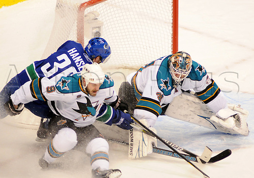 18.05.2011 San Jose Sharks goaltender Antti Niemi (31) makes a save on a shot by Vancouver Canucks forward Jannik Hansen (36) with help from Sharks defender Ian White (9) during game 2 of the Western Conference Finals in Vancouver, British Columbia on Wednesday night.