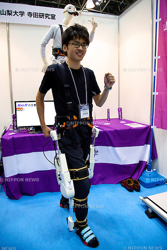 """An exhibitor uses the KAI-R (Knee Assistive Instruments for Rehabilitation) at the Japan Robot Week 2014 on October 16, 2014 in Tokyo, Japan. Companies at the """"Japan Robot Week 2014"""" exhibited their latest high-tech nursing and life supporting robots. The 2014 edition of the show ran from October 15 to 19 at Tokyo Big Sight. (Photo by Rodrigo Reyes Marin/AFLO)"""