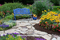 63821-21705 Blue bench, blue container, and stone path in flower garden.  Black-eyed Susans (Rudbeckia hirta) Red Dragon Wing Begonias (Begonia x hybrida) Homestead Purple Verbena, New Gold Lantana, Red Verbena, Butterfly Bushes, Sedum, Croton in blue pot, Marion Co., IL