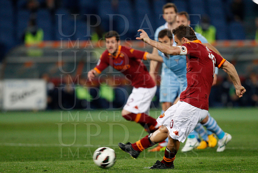Calcio, Serie A: Roma vs Lazio. Roma, stadio Olimpico, 8 aprile 2013..AS Roma forward Francesco Totti scores on a penalty kick during the Italian Serie A football match between AS Roma and Lazio at Rome's Olympic stadium, 8 April 2013..UPDATE IMAGES PRESS/Riccardo De Luca