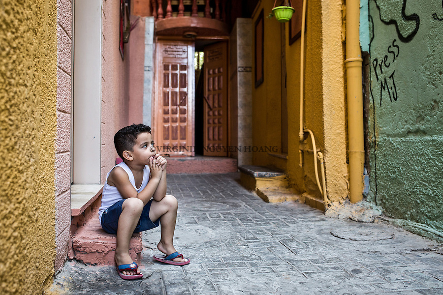 GAZA, Zaytoun: A young boy in his thoughts, just in front of his home. 09/08/15<br /> <br /> GAZA , Zaytoun : un petit gar&ccedil;on dans ses pens&eacute;es juste en face de chez lui. 09/08/15