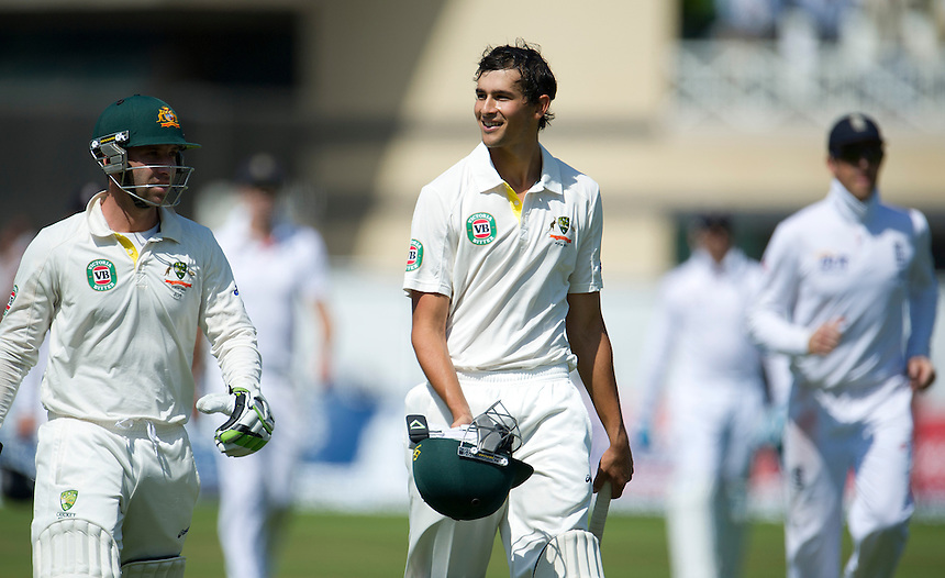 Australia's Ashton Agar ( R ) acknowledges the applause as he leaves the pitch with team-mate Phil Hughes after scoring 98 before being caught out on his test debut as a number 11, a world test record - AC Agar c Swann b Broad 98<br /> <br />  (Photo by Stephen White/CameraSport) <br /> <br /> International Cricket - First Investec Ashes Test Match - England v Australia - Day 2 - Thursday 11th July 2013 - Trent Bridge - Nottingham<br /> <br /> &copy; CameraSport - 43 Linden Ave. Countesthorpe. Leicester. England. LE8 5PG - Tel: +44 (0) 116 277 4147 - admin@camerasport.com - www.camerasport.com
