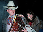 Larry Hagman and Linda Gray  ( DALLAS ).Arriving at Kennedy Airport,New York City. February 1982