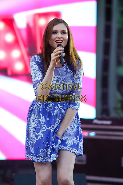 Sophie Ellis Bextor.Presentation of the TV channel 'Friday', Hermitage Garden, Moscow,.Russia, 7th August 2012..music live on stage performing performs concert gig half length blue lace dress white microphone singing belt black .CAP/PER/AS.©AS/PersonaStars/CapitalPictures