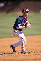 Shippensburg Raiders third baseman Ryan McMillen (10) on defense against the Belmont Abbey Crusaders at Abbey Yard on February 8, 2015 in Belmont, North Carolina.  The Raiders defeated the Crusaders 14-0.  (Brian Westerholt/Four Seam Images)