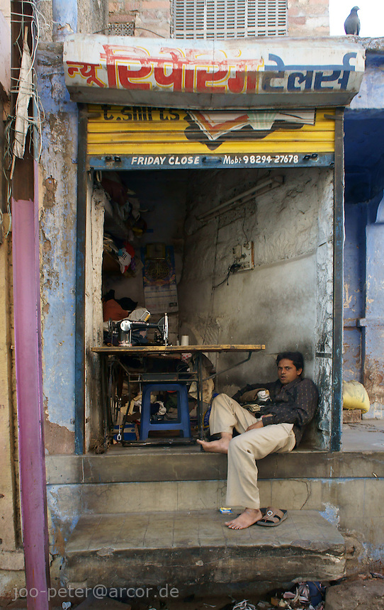 man sitting in front of his shop in Jodhpur, Rajastan, India