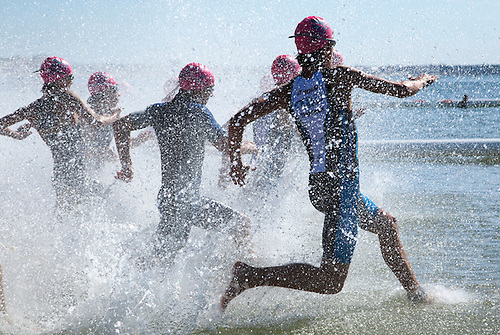 18 SEP 2010 - LA BAULE, FRA - Competitors run into the water at the start of the Tri-Avenir (Childrens Triathlon) at the 23rd Triathlon Audencia-La Baule (PHOTO (C) NIGEL FARROW)