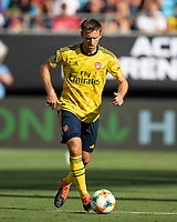 CHARLOTTE, NC - JULY 20: Calum Chambers #21 advances the ball during a game between ACF Fiorentina and Arsenal at Bank of America Stadium on July 20, 2019 in Charlotte, North Carolina.