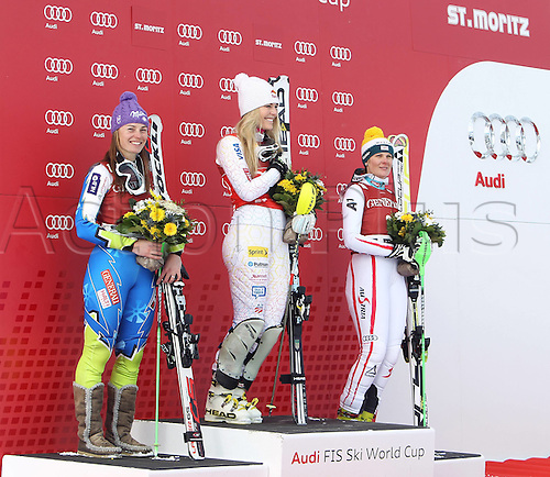 27.01.2012 St Moritz, Switzerland. The AUDI FIS Alpine Skiing World Cup Super Combination race, one run of downhill and one run of slalom held on the Engiadina course.  Award Ceremony Picture shows Tina Maze SLO Lindsey Vonn USA and Nicole Hosp AUT