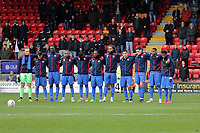 Maldon players observe a one minute silence on Remembrance Sunday during Leyton Orient vs Maldon & Tiptree, Emirates FA Cup Football at The Breyer Group Stadium on 10th November 2019