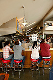 USA, California, Sausalito, guests sit on bar stools and eat lunch, Fish restaurant