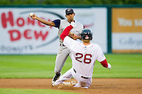 Eduardo Escobar #3 of the Charlotte Knights turns a double play as Lars Anderson #26 of the Pawtucket Red Sox slides into second base at McCoy Stadium on June 14, 2011 in Pawtucket, Rhode Island.  The Knights defeated the Red Sox 4-2 in 11 innings.    Photo by Brian Westerholt / Four Seam Images