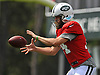 Ryan Fitzpatrick #14, New York Jets starting quarterback, takes a snap during team training camp at Atlantic Health Jets Training Center in Florham Park, NJ on Wednesday, Aug. 3, 2016.