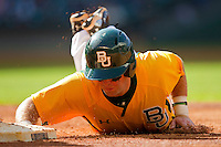 Joey Hainsfurther #1 of the Baylor Bears dives back to first base during the game against the Rice Owls at Minute Maid Park on March 6, 2011 in Houston, Texas.  Photo by Brian Westerholt / Four Seam Images