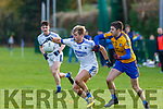 Fiachra Clifford Laune Rangers and Ger Hartnett Beaufort in action during their Mid Kerry semi Final in Beaufort on Saturday