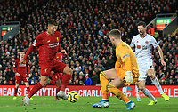 2nd January 2020; Anfield, Liverpool, Merseyside, England; English Premier League Football, Liverpool versus Sheffield United; Sheffield United goalkeeper Dean Henderson saves a shot from Roberto Firmino of Liverpool - Strictly Editorial Use Only. No use with unauthorized audio, video, data, fixture lists, club/league logos or 'live' services. Online in-match use limited to 120 images, no video emulation. No use in betting, games or single club/league/player publications