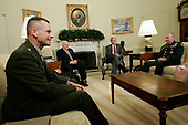 Washington, D.C. - June 14, 2007 -- United States President George W. Bush (3rd L) meets with Army Lieutenant General Martin E. Dempsey (R), former Commanding General of Multi-National Security and Transition Command Iraq, as Chairman of the Joint Chiefs of Staff General Peter Pace (L) and Vice President Dick Cheney (2nd L) look on in the Oval Office of the White House on Thursday, June 14, 2007 in Washington, DC. U.S. Army Lieutenant General James Dubik has succeeded Dempsey to take over the command on June 10, 2007 in Baghdad. <br /> Credit: Alex Wong - Pool via CNP