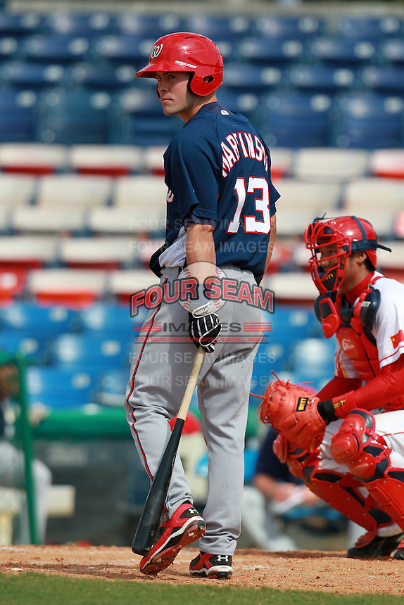 Washington Nationals minor league shortstop Jason Martinson (13) during a game vs. the Chinese National Team in an Instructional League game at Holman Stadium in Vero Beach, Florida September 30, 2010.   Photo By Mike Janes/Four Seam Images