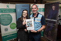 Denada Berisha of Remus Uomo gives a raffle prize to Adrian Hill