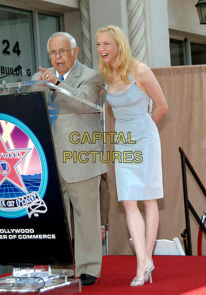 JOHNNY GRANT & RENEE ZELLWEGER.Honored with a Star on the Hollywood Walk of Fame for Her Achievements in Film on Hollywood Boulevard. .May 24th, 2005.Photo Credit: Jacqui Wong/AdMedia.full length podium blue dress.www.capitalpictures.com.sales@capitalpictures.com.© Capital Pictures.
