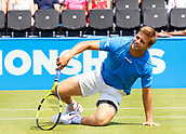 June 19th 2017, Queens Club, West Kensington, London; Aegon Tennis Championships, Day 1; Ryan Harrison (USA) takes a tumble during his first round singles match against number six seed Grigor Dimitrov (BUL)