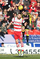 Doncaster Rovers' Andrew Butler jumps with  Rotherham United's Ryan Williams<br /> <br /> Photographer Mick Walker/CameraSport<br /> <br /> The EFL Sky Bet League One - Doncaster Rovers v Rotherham United - Saturday 11th November 2017 - Keepmoat Stadium - Doncaster<br /> <br /> World Copyright &copy; 2017 CameraSport. All rights reserved. 43 Linden Ave. Countesthorpe. Leicester. England. LE8 5PG - Tel: +44 (0) 116 277 4147 - admin@camerasport.com - www.camerasport.com