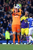 Pictured: Gerhard Tremmel of Swansea thanks away supporters. Sunday 16 February 2014<br /> Re: FA Cup, Everton v Swansea City FC at Goodison Park, Liverpool, UK.