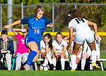 BURLINGTON ,  CT-101519JS17-  Lewis Mills'  Makayla Issakhani (26) looks to get around Newington's Alexi Armour (14) during their game Tuesday at Nassahegan Field in Burlington. <br /> Jim Shannon Republican-American