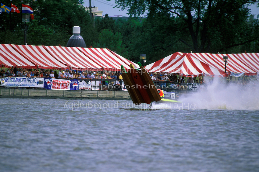 Frame 4: Halfway around the first lap, Wyatt Nelson (#39) blows the boat over crashing back to the water. Nelson was unhurt in the crash. (SST-120 class) Bay City, MI 1998
