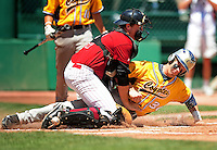 May 31, 2010; Grand Junction, CO, USA; Southern Nevada Coyotes base runner Bryce Harper successfully steals home as Faulkner State Sun Chiefs catcher Stephen Clarke drops the ball in the first inning during the Junior College World Series as Suplizio Field. Southern Nevada won the game 18-1. Mandatory Credit: Mark J. Rebilas-