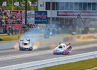 May 5, 2019; Commerce, GA, USA; NHRA funny car driver Terry Haddock (left) loses traction and goes sideways alongside Robert Hight during the Southern Nationals at Atlanta Dragway. Mandatory Credit: Mark J. Rebilas-USA TODAY Sports