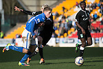 St Johnstone v Hibs...22.03.14    SPFL<br /> David Wotherspoon fends off Ryan McGivern<br /> Picture by Graeme Hart.<br /> Copyright Perthshire Picture Agency<br /> Tel: 01738 623350  Mobile: 07990 594431