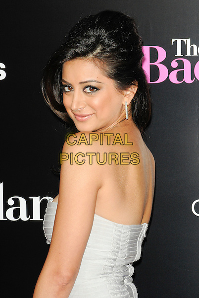 "NOUREEN DEWULF .arriving at the premiere of CBS Films' ""The Back-up Plan"" at the Regency Village Theatre in Westwood, California, USA, April 21st 2010..arrivals half length strapless white side looking back over shoulder rear behind .CAP/ROT.©Lee Roth/Capital Pictures"