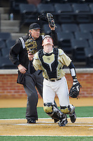 Wake Forest Demon Deacons catcher Garrett Kelly (28) tracks a foul pop fly against the Marshall Thundering Herd at Wake Forest Baseball Park on February 17, 2014 in Winston-Salem, North Carolina.  The Demon Deacons defeated the Thundering Herd 4-3.  (Brian Westerholt/Four Seam Images)