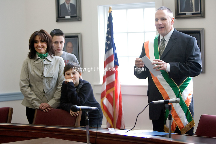 WOLCOTT, CT. 17 March 2012-031712SV02-Bob Stoeckert, Irish Mayor for the Day, with his family, Kelly Stoeckert, his wife, Bobby, 12, and Matt, 9 , his sons, at town hall in Wolcott Saturday. .Steven Valenti Republican-American